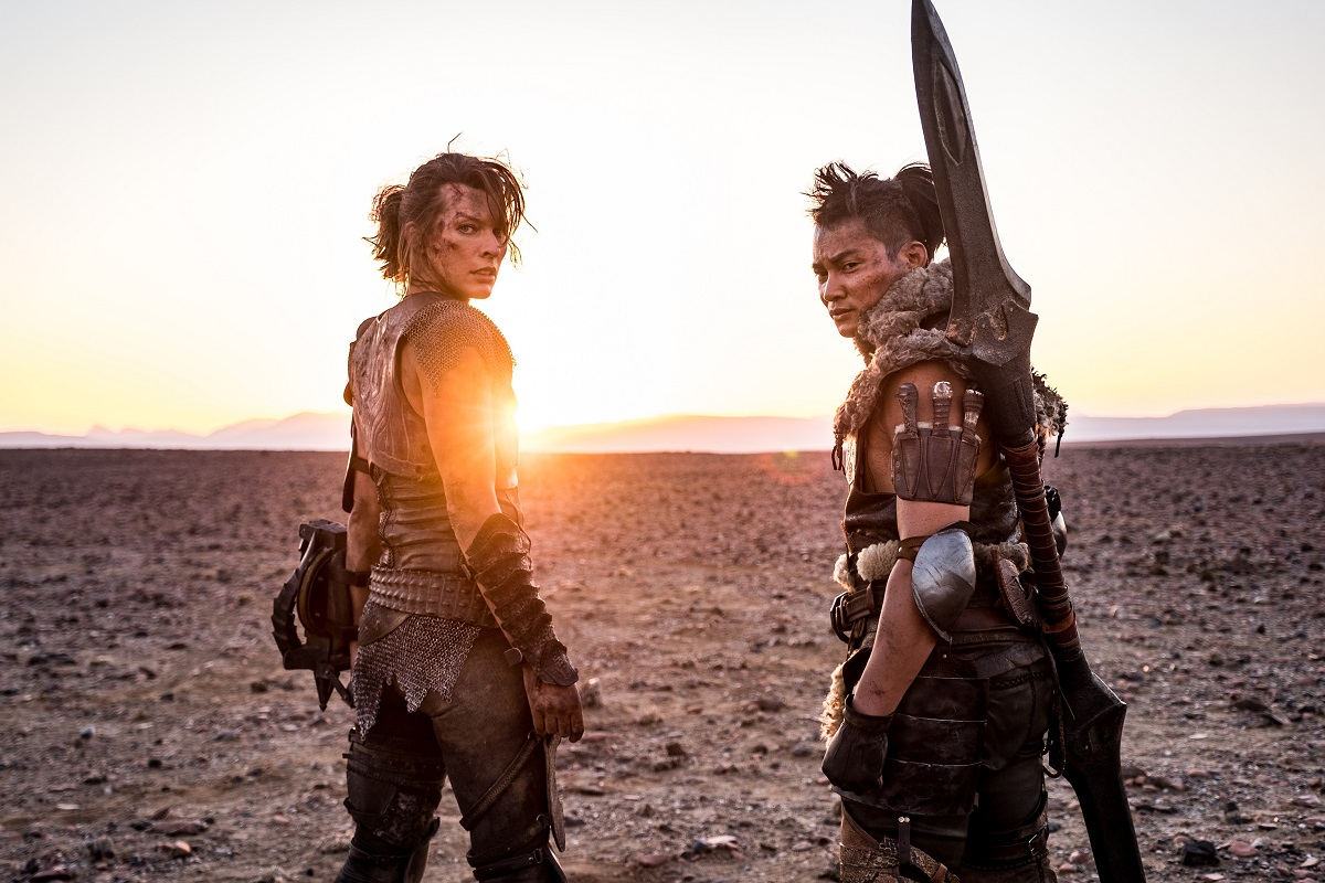 "(L-R) """"ARTEMIS"""" (Milla Jovovich) and """"HUNTER"""" (Tony Jaa) on set in Screen Gems and Constantin Films' MONSTER HUNTER."